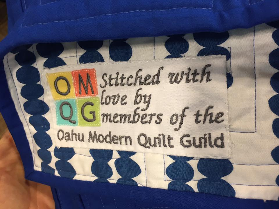 quilt label embroidered by Trinia!